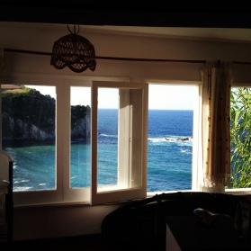Beach house window view.