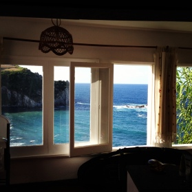 Beach house window view.