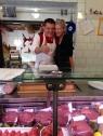 Mom behind the counter with Dario Cecchini, the Butcher of Panzano